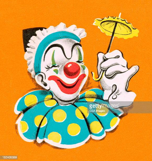 Clown tenant petite ombrelle