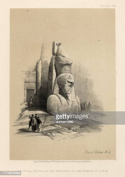 colossal statue at the entrance to the temple of luxor - thebes egypt stock illustrations