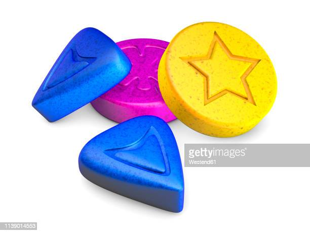colourful ecstasy pills on white ground, 3d rendering - triangle shape stock illustrations