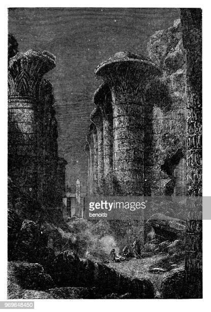 columns of karnak - thebes egypt stock illustrations