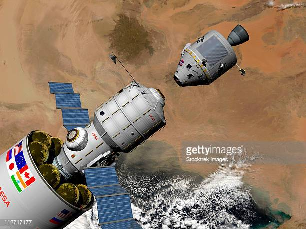 A command module prepares to dock with a Phobos mission rocket in Earth orbit.