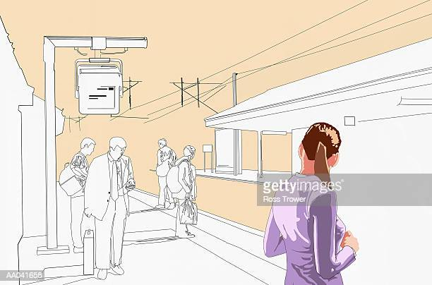Commuters waiting on train platform (Digital)