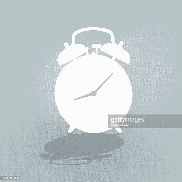 composite image of alarm clock against gray background - alertness stock illustrations