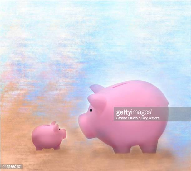concept image of a big and  a small piggy bank looking at each other - other stock illustrations, clip art, cartoons, & icons