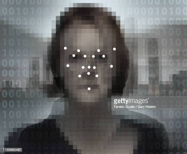 Concept image of a digitised face overlaid with a biometric facial recognition pattern