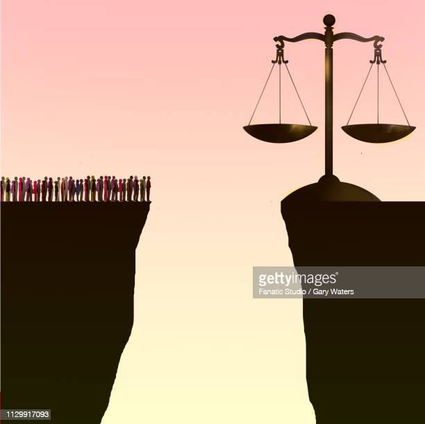 concept image of a group of people separated from the scales of justice by a large chasm depicting inability to get justice - unfairness stock illustrations