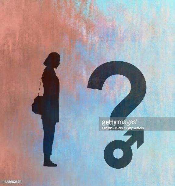 concept image of a woman looking at a question mark where the dot forms a male symbol depicting gender questioning