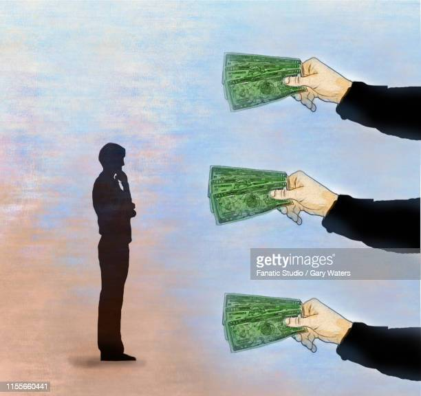 concept image of three hands offering money to a man who is thinking  depicting financial decision making - bribing stock illustrations