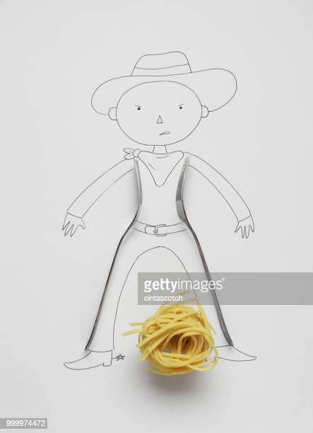 Conceptual cowboy standing by tumbleweed