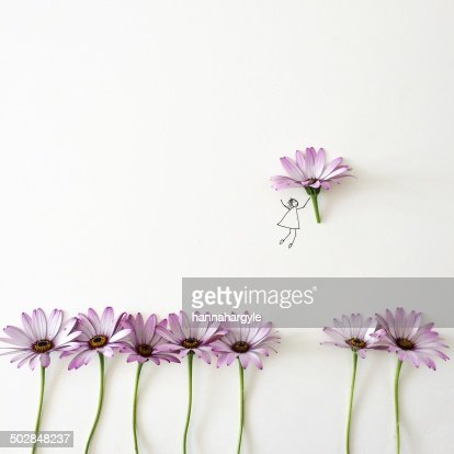 Conceptual girl picking flower