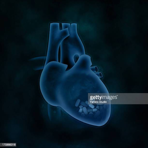 conceptual shot of capsules in heart representing heart issues - myocardium stock illustrations, clip art, cartoons, & icons