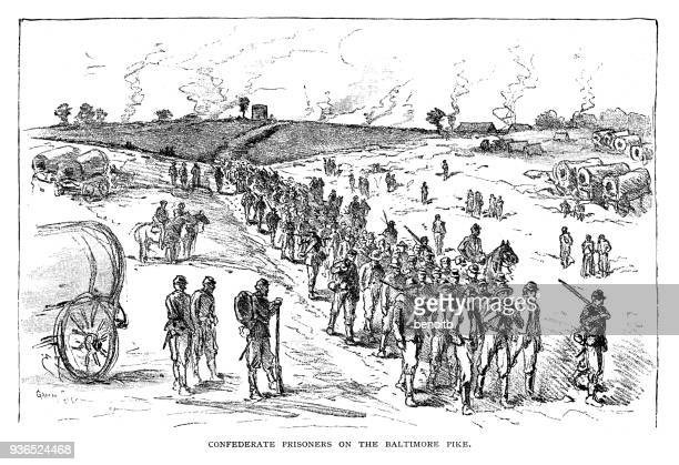 confederate army prisoners on the baltimore pike - prisoner stock illustrations
