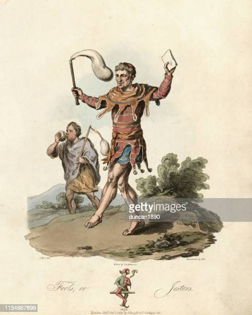 costume of a medieval jester and fool, 13th century - period costume stock illustrations
