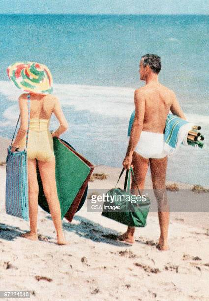 couple at the beach - rear view stock illustrations