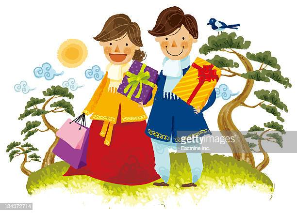 Couple carrying gifts boxes and shopping bag