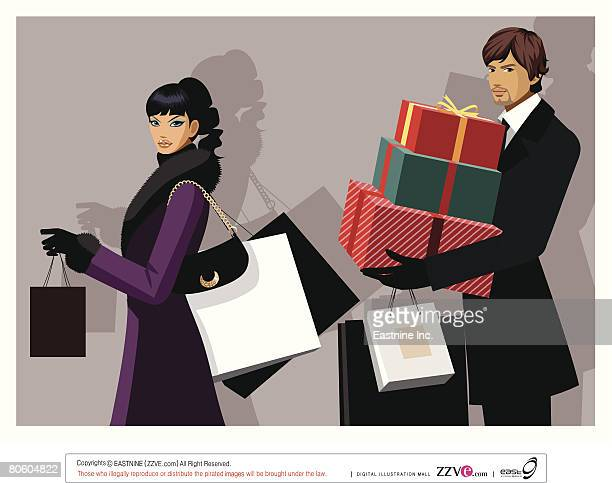 Couple carrying shopping bags and Christmas presents