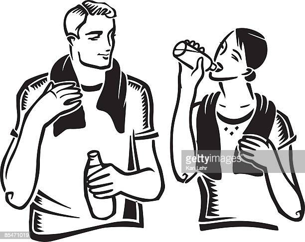 A couple drinking water after exercising