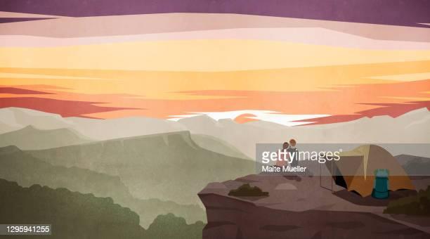 couple enjoying majestic sunset mountain view outside tent - vacations stock illustrations