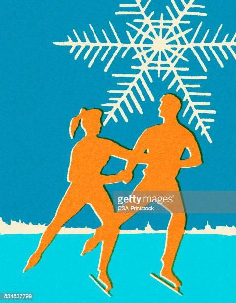 カップルのアイススケート