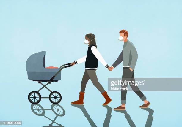 couple in flu masks holding hands and walking baby in stroller - baby stock illustrations