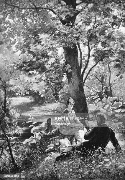 Couple in love sit under a tree in the park and read a book _ 1895