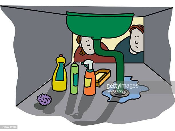 A couple looking at a leaky sink