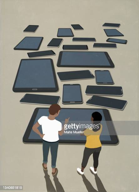 couple looking at variety of smart phones and digital tablets - computer stock illustrations