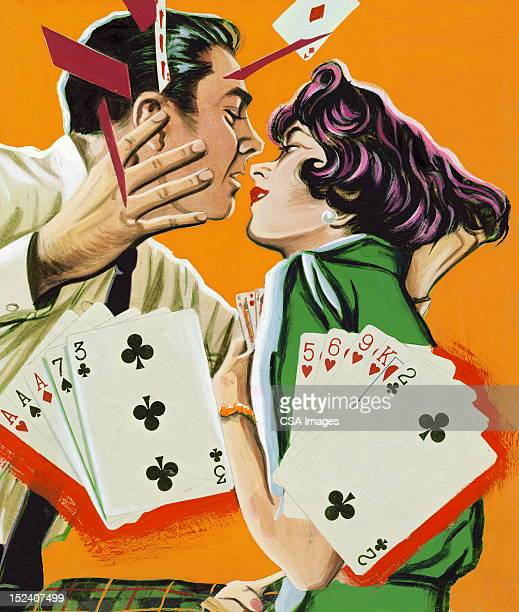 Couple Playing Cards and About to Kiss