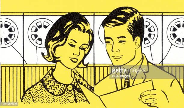 Couple reading transcript