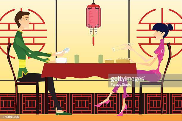 Couple sitting in a Chinese restaurant