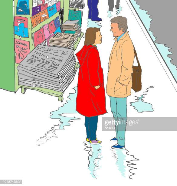 couple talking in front of newspaper kiosk