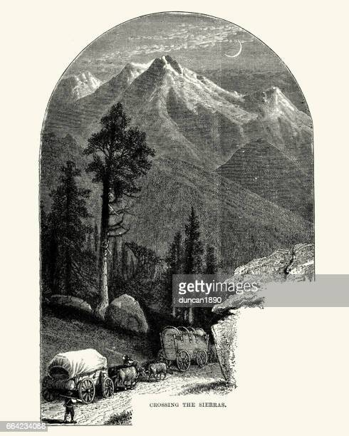 covered wagons crossing the sierra nevada, 19th century - horse cart stock illustrations, clip art, cartoons, & icons