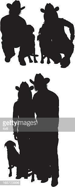 Cowboy couple with dogs