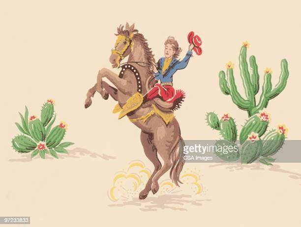 ilustrações de stock, clip art, desenhos animados e ícones de cowboy no horseback no deserto - rodeio