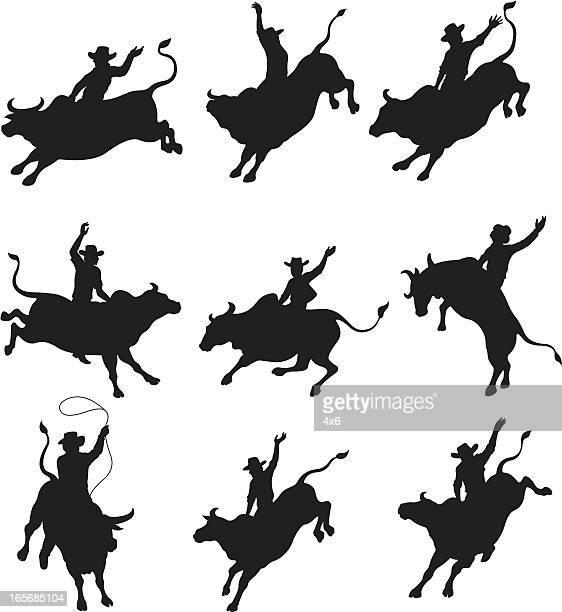 ilustrações de stock, clip art, desenhos animados e ícones de cowboys de rodeio equilíbrio sobre bulls - rodeio