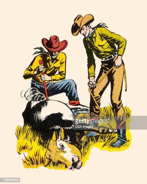 Cowboys Branding a Steer
