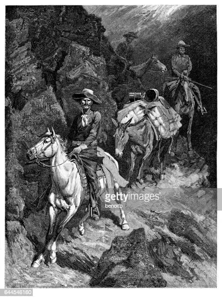 Cowboys riding on a canyon trail