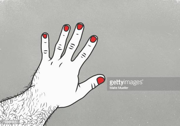 Cropped image of man with red nail polish on finger against gray background