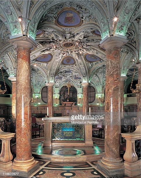Italy; Lombardy; Milan; Santa Maria Nascente Dome Cathedral. Interior crypt St Charles scurolo columns marble stucco floor altar
