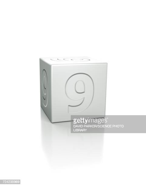 Cube with the number 9 embossed