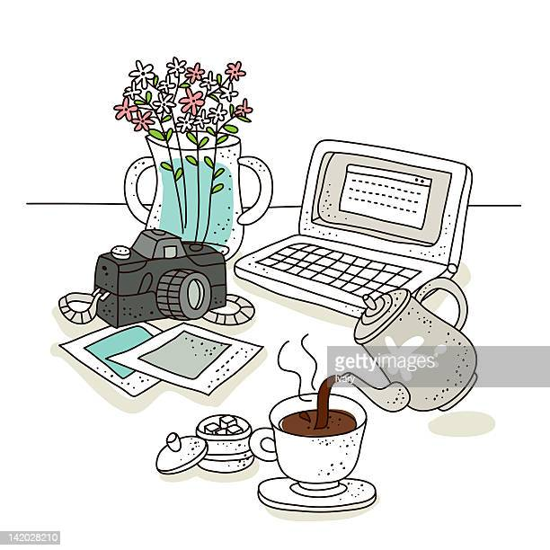 cup of coffee with laptop and digital camera - sugar cube stock illustrations, clip art, cartoons, & icons