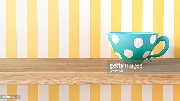 Cup with dots in front of striped wallpaper