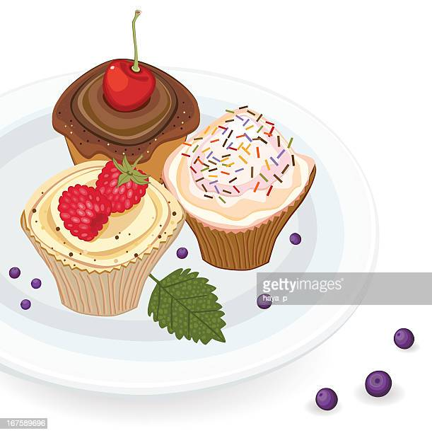Cupcakes With Fruit And Candy Toppings