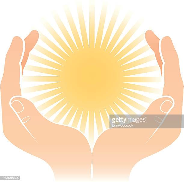 Cupped hands and sunburst.