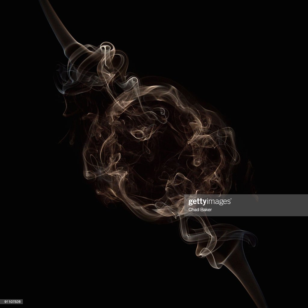 Curls of smoke creating circular frame : Illustrationer