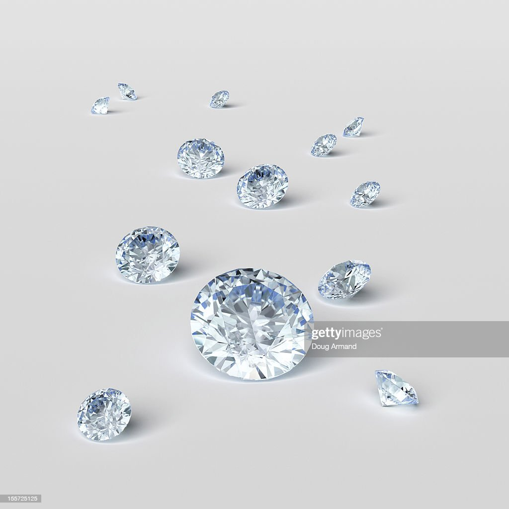 Cut diamonds on white surface : stock illustration