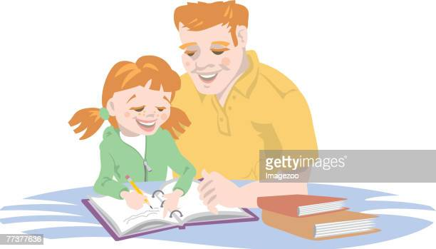 dad helping his daughter with homework