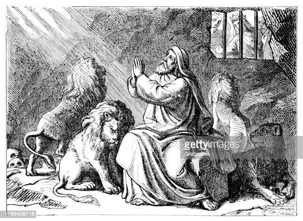 daniel in the lions' den - biblical event stock illustrations