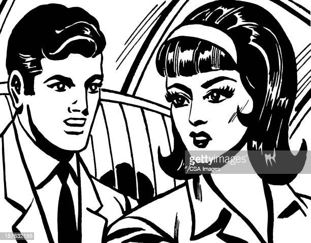 Dark Haired Man and Woman in Car