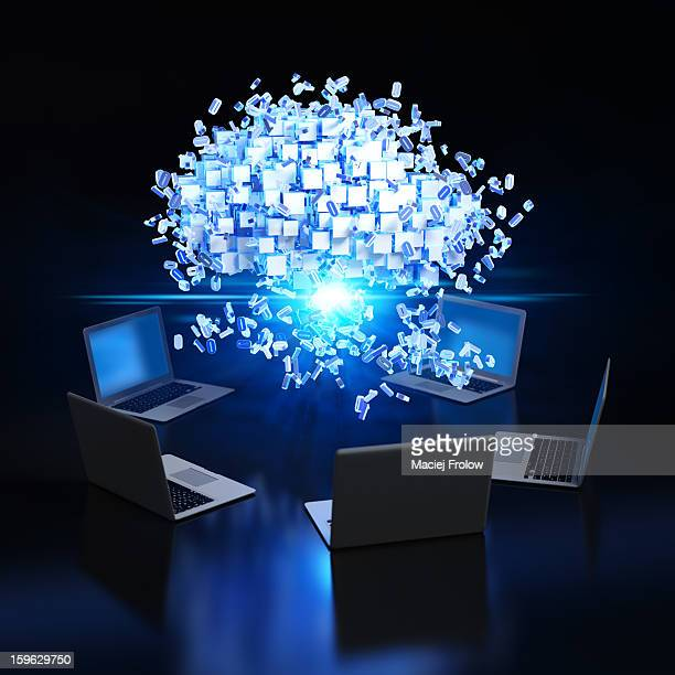 Data cloud over computers with flying numbers